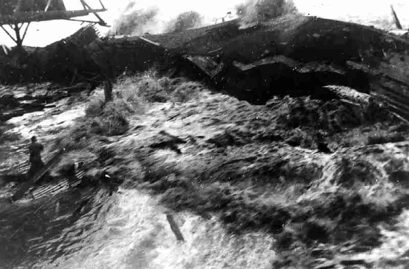 Tsunami hitting pier, Hilo HI, 01-APR-1946; Time for the man pictured at left: about as 'Late' as it is possible to get.